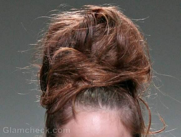 voluminous messy top bun hairdo