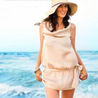 Style picture wearing cowl necked short belted dress