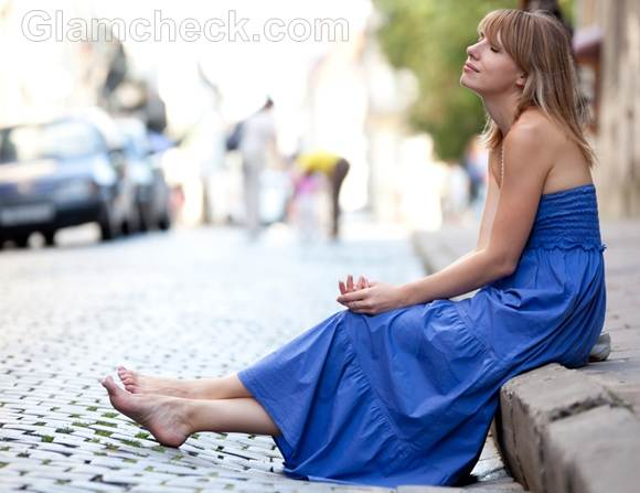 Style picture wearing strapless blue maxi dress