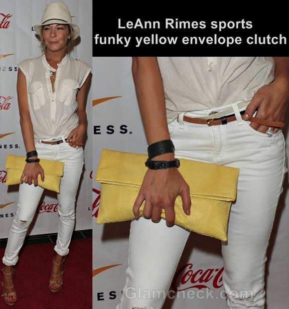 yellow envelope clutch with white pants LeAnn Rimes