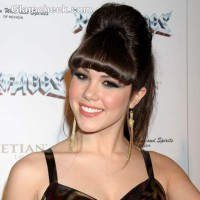 Claire Sinclair sports Beehive Ponytail Hairstyle