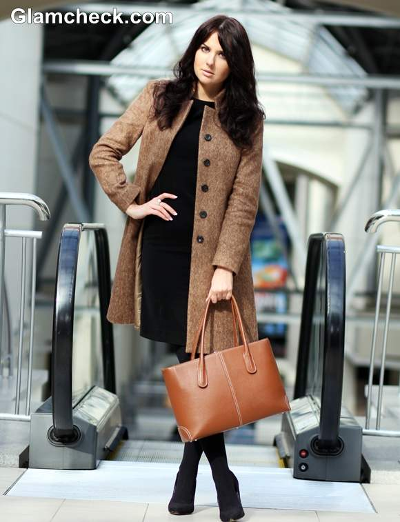 wearing black dress with camel coat winter styling tips