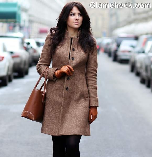 winter styling tips wearing black dress with camel coat