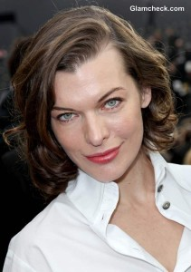Milla Jovovich Androgynous at Paris Fashion Week F-W 2013