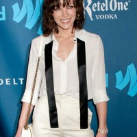 Milla Jovovich Sports Classy Androgynous Look at GLAAD Awards