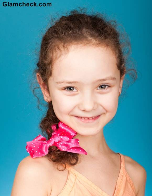 Little girl hairstyles with bow hair accessories
