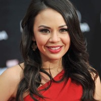 Janel Parrish ear tattoo