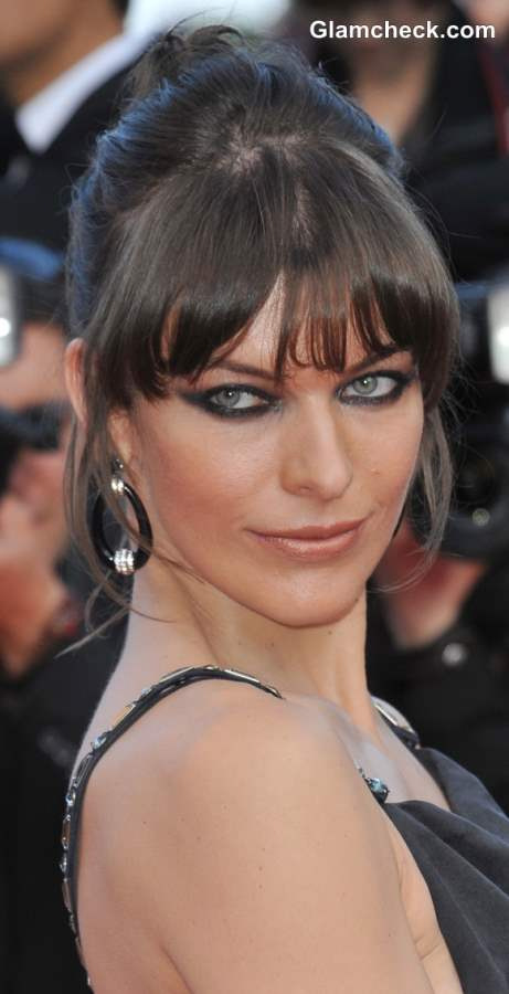 Hairstyling Fine Hair like Milla Jovovich Bun with Bangs
