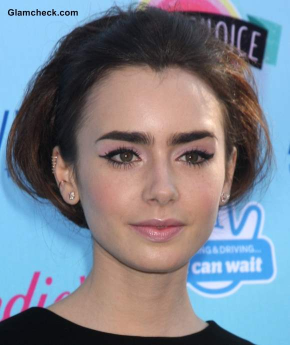 Lily Collins in 60s Hairstyle and Makeup