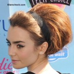 Lily Collins in 60s Style Bun and Makeup 2013