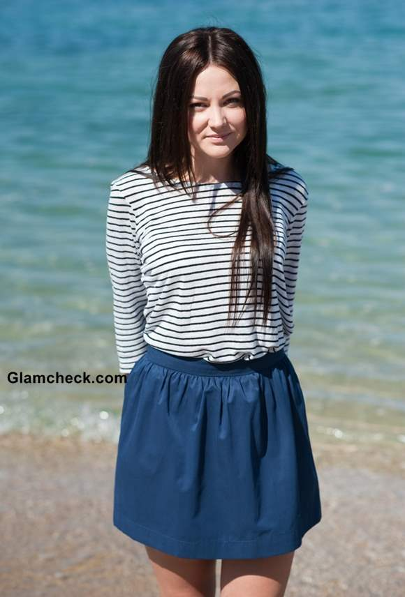 Wearing striped top with short skirt