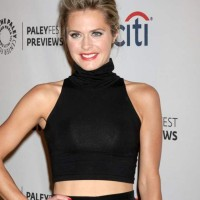 Black crop top worn with black skirt Maggie Lawson