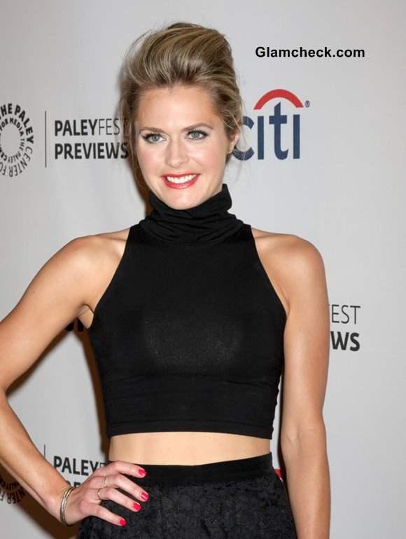 Black crop top worn with black skirt Maggie Lawson