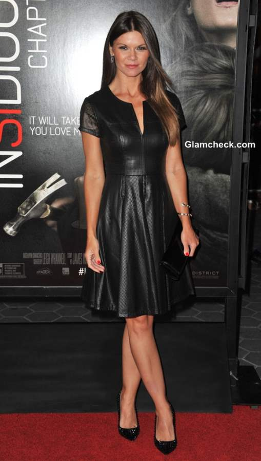 Danielle Vasinova in a leather dress