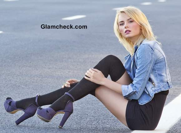 Wearing little black dress with denim jacket and long leather boots