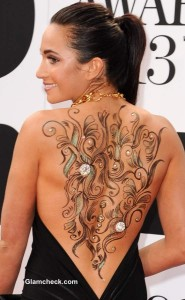 Baby's Got a Back Tattoo –  Laura Wright Shows Off Sexy Body Art in Backless Dress