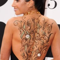 Laura Wright Shows Off Sexy Body Art in Backless Dress