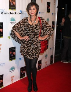 Pam Tillis Sports Leopard Print KaftanTop to Enter Miss Thang Book Launch Party