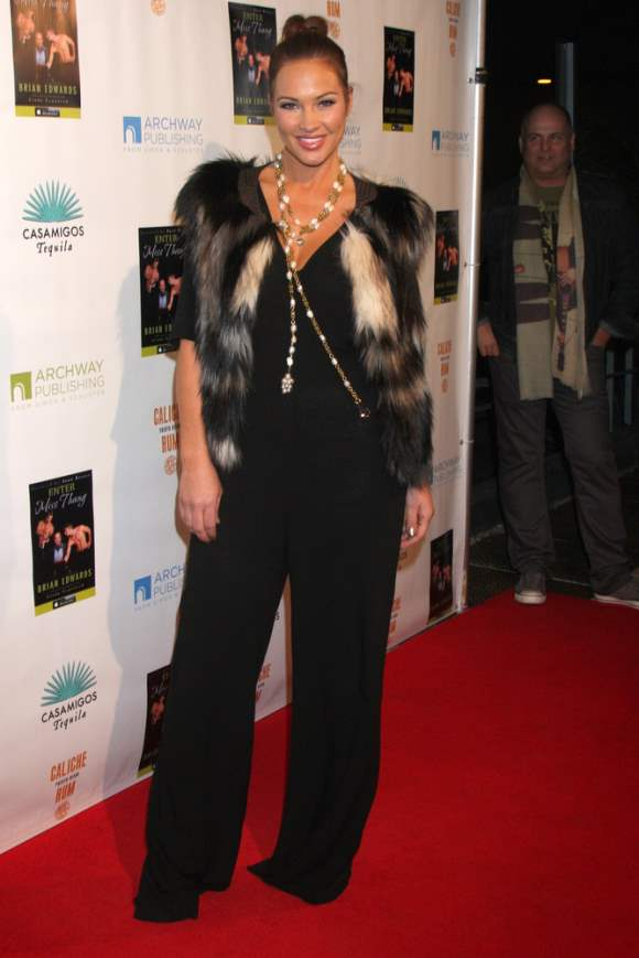 Tiffany Fallon in Black Jumpsuit and Fur Jacket at Enter Miss Thang Launch Party