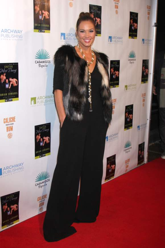 Tiffany Fallon In Black Jumpsuit And Fur Jacket At Enter Miss Thang
