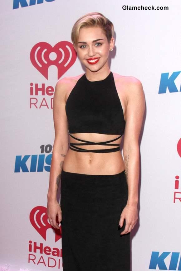 Miley Cyrus in a Black Strappy Crop Top