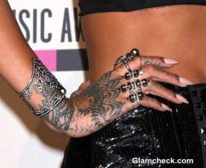 Rihanna in Silver Diamond Accessories and Graphic Tattoos at AMA 2013