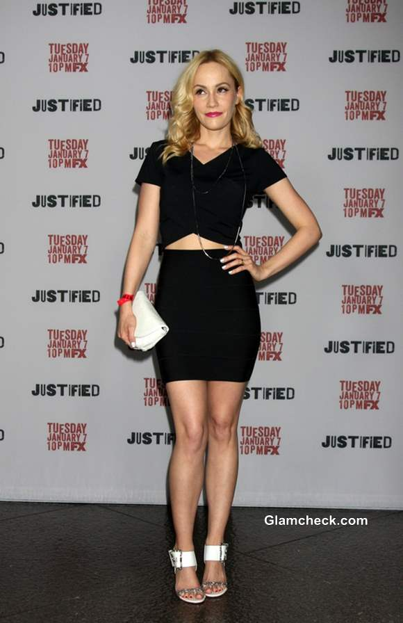 Cathy Baron in a black cutout skirt-blouse style dress