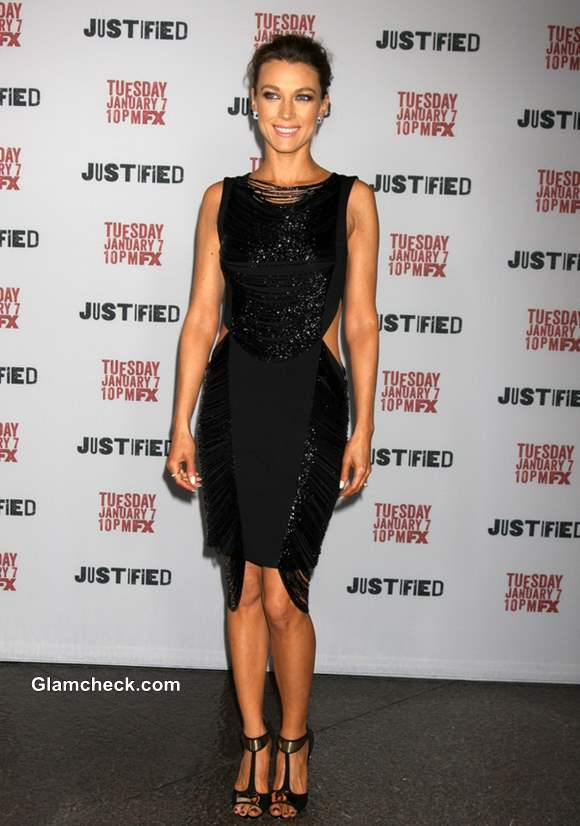 Natalie Zea in a black cutout slinky-shimmery dress