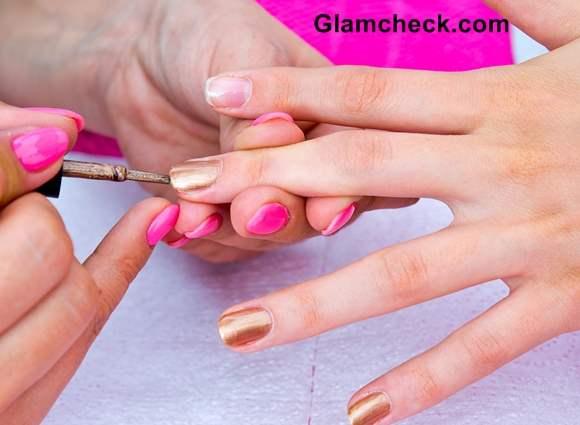 Apply a coat of Gold nail polish