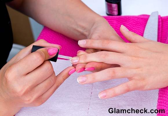 Apply a coat of the clear nail varnish