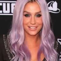 Kesha flaunting her lilac purple hair at the Planes Fire Rescue World Premiere