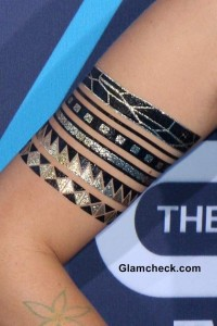 Colbie Caillat shows off her Flash Tattoos at the Young Hollywood Awards