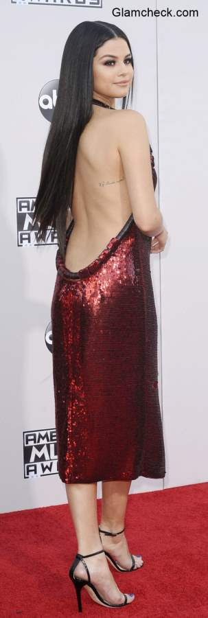 Backless Gown - Selena Golmez goes Backless  at 2015 AMA