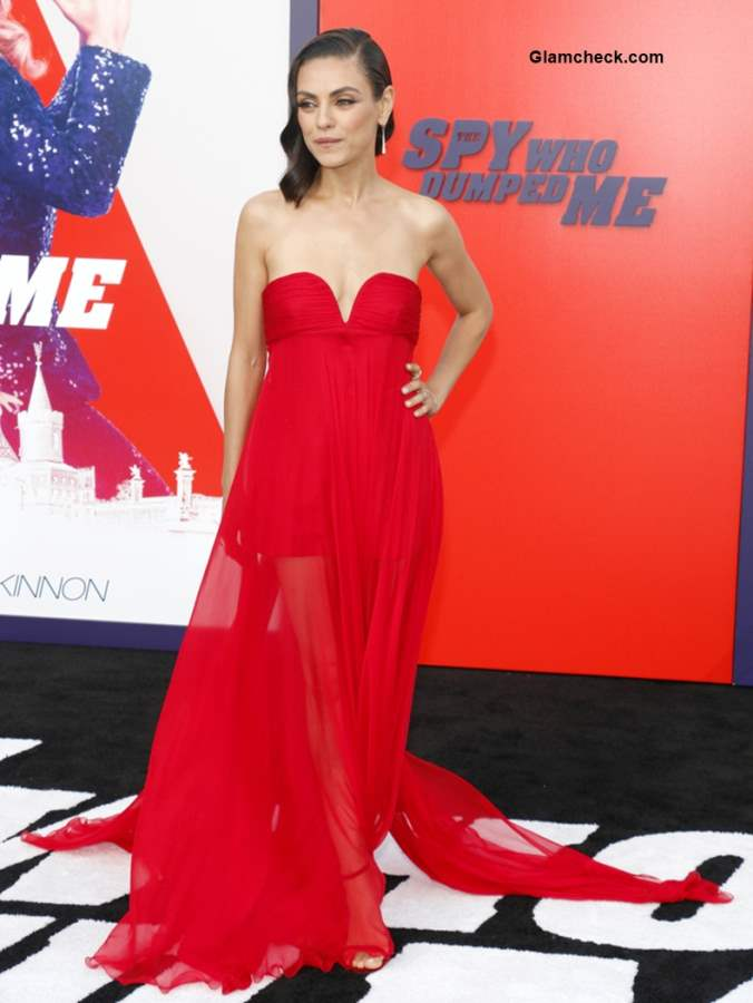 Mila Kunis in Valentino red gown at The Spy Who Dumped Me LA Premier