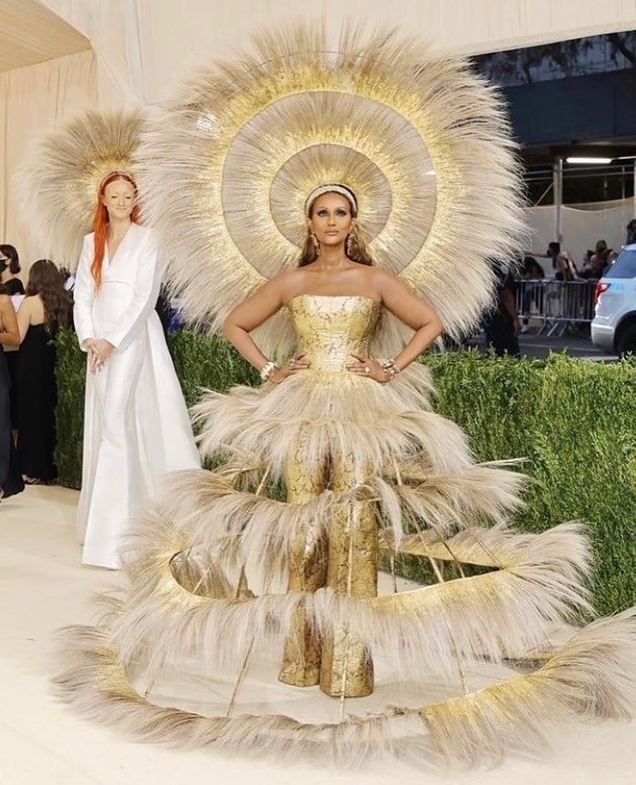 MET Gala 2021 Red Carpet Looks Iman in Harrris Reed Feather Fringe Golden Outfit